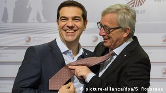 Alexis Tsipras and Jean Claude Juncker laughing together Stefan Rousseau/PA Wire URN:23086895