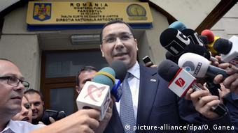 Victor Ponta speaks to reporters outside the DNA in Bucharest