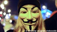 A protestor wears a Guy Fawkes mask at the Szabadsag (Freedom) Bridge during the so-called 'Million Mask March' demonstration in Budapest on November 5, 2014 against corruption and inequalities in society. AFP PHOTO / ATTILA KISBENEDEK (Photo credit should read ATTILA KISBENEDEK/AFP/Getty Images)