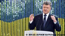 Ukrainian Prsident Petro Poroshenko gastures as he speaks during the press-conference for domestic and foreign media in Kiev on June 5, 2015. Poroshenko said on Friday that Russia had deployed an unprecedented amount of troops on the border with Ukraine as well as claiming there are already thousands of troops in the rebel-held east of the ex-Soviet country. Poroshenko was also set to meet with Japanese Prime Minister Shinzo Abe, who is to visit Kiev ahead of the summit in a show of support. AFP PHOTO/ SERGEI SUPINSKY (Photo credit should read SERGEI SUPINSKY/AFP/Getty Images)