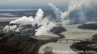 Aerial view of oil sands extraction facility on the banks of the Athabasca River in Alberta Province, Canada