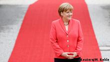 08.06.2015 **** German Chancellor Angela Merkel waits to welome outreach delegates at the G7 summit at Elmau Castle hotel in Kruen near Garmisch-Partenkirchen, southern Germany, June 8, 2015. Leaders of the Group of Seven (G7) industrial nations vowed at a summit in the Bavarian Alps on Sunday to keep sanctions against Russia in place until President Vladimir Putin and Moscow-backed separatists fully implement the terms of a peace deal for Ukraine. REUTERS/Michaela Rehle TPX IMAGES OF THE DAY