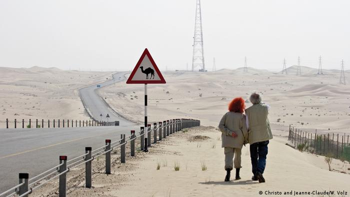 Christo and Jeannne-Claude walking along a road in the UAE (Christo and Jeanne-Claude/W. Volz)