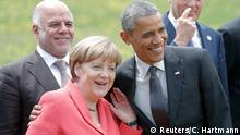 08.06.2015 *** German Chancellor Angela Merkel poses with U.S. President Barack Obama for a family picture at the G7 summit at the Elmau castle in Kruen near Garmisch-Partenkirchen, Germany, June 8, 2015. Leaders of the Group of Seven (G7) industrial nations vowed at a summit in the Bavarian Alps on Sunday to keep sanctions against Russia in place until President Vladimir Putin and Moscow-backed separatists fully implement the terms of a peace deal for Ukraine. REUTERS/Christian Hartmann TPX IMAGES OF THE DAY