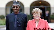 German Chancellor Angela Merkel welcomes outreach delegate Nigerian President Muhammadu Buhari to the G7 summit at Elmau Castle hotel in Kruen near Garmisch-Partenkirchen, southern Germany, June 8, 2015. Leaders of the Group of Seven (G7) industrial nations vowed at a summit in the Bavarian Alps on Sunday to keep sanctions against Russia in place until President Vladimir Putin and Moscow-backed separatists fully implement the terms of a peace deal for Ukraine. REUTERS/Christian Hartmann