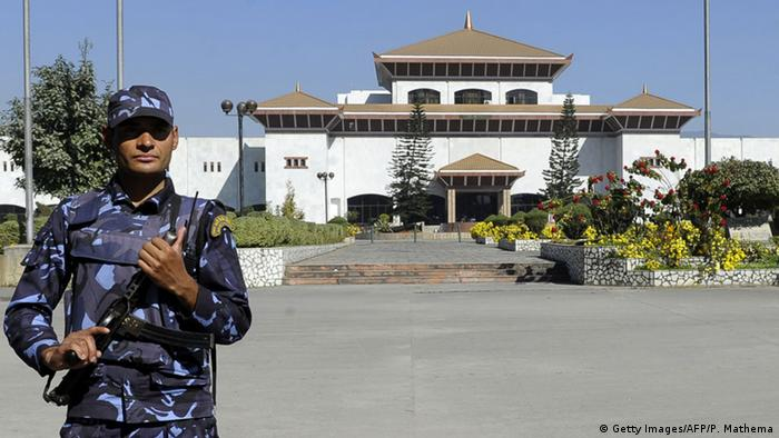 A Nepalese police officer stands guard in front of the parliament building in Kathmandu (Photo: PRAKASH MATHEMA/AFP/Getty Images)
