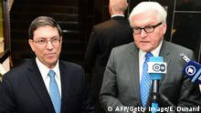 Germany's Foreign Minister Frank-Walter Steinmeier (R) and his Cuban counterpart Bruno Rodriguez Parrilla talk to the press after a bilateral meeting which took place on the sidelines of an EU-CELAC (Community of Latin American and Caribbean States) foreign ministers meeting at the European Commission in Brussels, June 9, 2015. The foreign ministers met ahead of an EU-CELAC (Community of Latin American and Caribbean States) leaders' summit scheduled to take place on June 10-11 June. AFP PHOTO/Emmanuel Dunand (Photo credit should read EMMANUEL DUNAND/AFP/Getty Images)