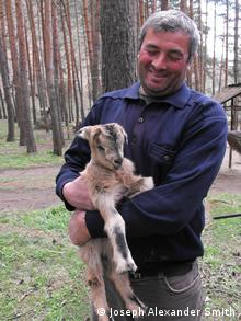 Ranger in Borjomi-Kharagauli National Park holds bezoar goat (Photo: Joseph Alexander Smith)