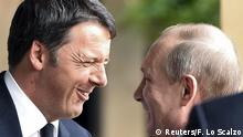 10.06.2015*** Italian Prime Minister Matteo Renzi (L) smiles as he meets Russian President Vladimir Putin at the Expo 2015 global fair in Milan, northern Italy, June 10, 2015. The Russian leader is due to meet Prime Minister Matteo Renzi at the Expo 2015 global fair in Milan, two weeks before the EU decides whether to extend the economic sanctions imposed on Moscow after it annexed Crimea from Ukraine in March 2014. REUTERS/Flavio Lo Scalzo