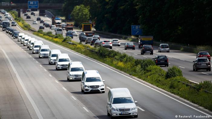 A convoy of hearses carry the victims' remains
