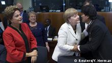 10.06.2015 Brazil's President Dilma Rousseff (L) and Chile's President Michelle Bachelet (2nd L) look at German Chancellor Angela Merkel (2nd R) greet Bolivia's President Evo Morales at an EU-CELAC Latin America summit in Brussels, Belgium June 10, 2015. REUTERS/Yves Herman
