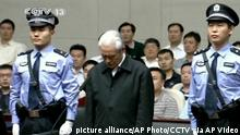 In this image taken from video released by China's CCTV via AP Video, Zhou Yongkang, center, formerly the Chinese Communist Party Politburo Standing Committee member in charge of security, is flanked by police guards as he stands in a courtroom at the First Intermediate People's Court of Tianjin in Tianjin, China, Thursday, June 11, 2015. Zhou was sentenced Thursday to life in prison on corruption charges, in a victory for President Xi Jinping's anti-graft campaign seen as further cementing his authority by removing a potential challenger. (AP Photo/CCTV via AP Video) CHINA OUT, NO SALES, NO ARCHIVES, EDITORIAL USE ONLY