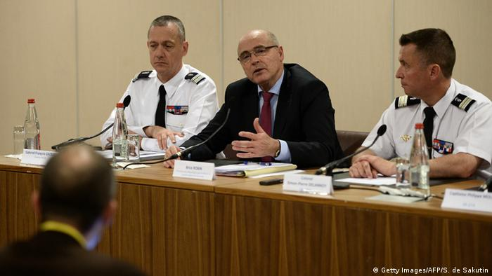 French prosecutor of Marseille Brice Robin (C) speaks as French Col. Francois Daoust (L), head of the criminal research Institute of the French Gendarmerie, and French Col. Simon-Pierre Delannoy, head of the research section of the The Air Transport Gendarmerie listen during a press conference on the March 2015 Germanwings plane crash, on June 11, 2015 in Paris.