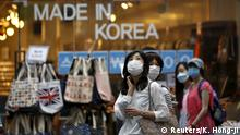 11.06.2015+++ Tourists wearing masks to prevent contracting Middle East Respiratory Syndrome (MERS) look around Myeongdong shopping district in central Seoul, South Korea, June 11, 2015. An outbreak of Middle East Respiratory Syndrome (MERS) forced South Korea to cut interest rates on Thursday in the hope of softening the blow to an economy already burdened by slack demand, as authorities reported 14 new cases. REUTERS/Kim Hong-Ji TPX IMAGES OF THE DAY