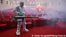 12.06.2015+++ South Korean health officials fumigate a theater while wearing protective gear in Seoul on June 12, 2015. South Korea on June 12, reported four more cases of Middle East Respiratory Syndrome (MERS), bringing to 126 the total number of people diagnosed with the potentially deadly virus. AFP PHOTO / JUNG YEON-JE (Photo credit should read JUNG YEON-JE/AFP/Getty Images)