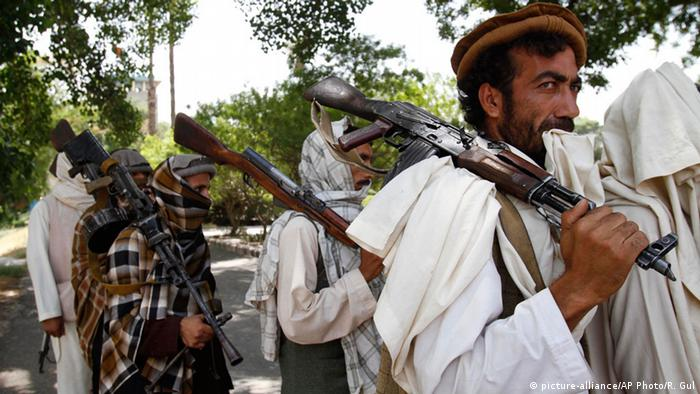 Taliban fighters hold their heavy and light weapons before surrendering them to Afghan authorities in Jalalabad, east of Kabul, Afghanistan (AP Photo/Rahmat Gul, File)
