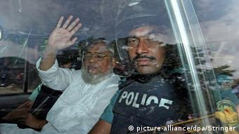 Jamaat-e-Islami Secretary General Ali Ahsan Mohammad Mujaheed (L) is taken to the International Crimes Tribunal in Dhaka, Bangladesh