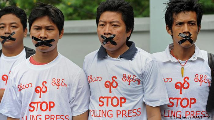 Myanmar journalists wearing T-shirts that say 'Stop Killing Press' stage a silent protest for five journalists who were jailed for 10 years on July 10, near the Myanmar Peace Center where Myanmar President Thein Sein was scheduled to meet with local artists in Yangon on July 12, 2014 (Photo: Soe Than WIN/AFP/Getty Images)
