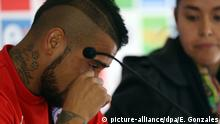 epa04805174 Chilean national team player Arturo Vidal cries during a press conference at complex Fernando Riera in Santiago, Chile, 17 June 2015. Vidal, who was involved in a car accident this Tuesday night, was freed due a court decision this morning, while Chilean coach Jorge Sampaoli said he will not be expelled out of the team, for they upcoming Copa America 2015 match against Bolivia on next 19 June. EPA/Elvis Gonzalez +++(c) dpa - Bildfunk+++