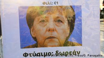 Poster with Greek writing and Merkel's face. (Photo: George Panagakis / Pacific Press)