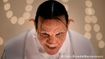 In Haunting Pig Mask With Devilish Grin Till Lindemanns Natural Milieu