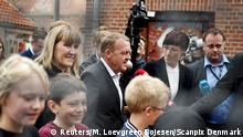 *** 18.06.2015 ***Leader of opposition party Venstre, Lars Loekke Rasmussen (C) and his wife Solrun Jakupsdottir (C, L) arrive at Nyboder school to cast their vote, during general election in Copenhagen, June 18, 2015. Danes voted on Thursday in a cliff-hanger election, where an opposition centre-right alliance is seeking to oust Prime Minister Helle Thorning-Schmidt, who is gambling that an economic revival will secure her a new term. REUTERS/Mathias Loevgreen Bojesen/Scanpix Denmark ATTENTION EDITORS - THIS IMAGE WAS PROVIDED BY A THIRD PARTY. NOT FOR SALE FOR MARKETING OR ADVERTISING CAMPAIGNS. THIS PICTURE IS DISTRIBUTED EXACTLY AS RECEIVED BY REUTERS, AS A SERVICE TO CLIENTS. DENMARK OUT. NO COMMERCIAL OR EDITORIAL SALES IN DENMARK. NO COMMERCIAL SALES.