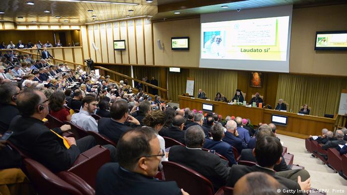 Journalists and guests follow the official presentation of Pope Francis's encyclical