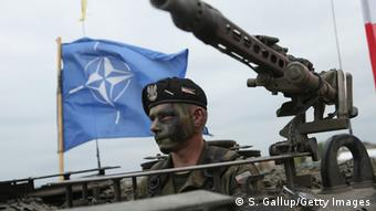 A Polish soldier sits in a tank during the NATO Noble Jump military exercises on June 18, 2015, in Zagan