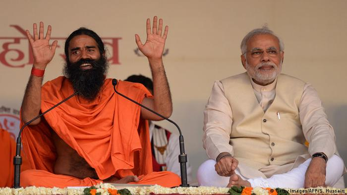 Indian yoga guru Baba Ramdev with PM Narednra Modi