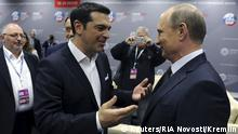 June 19, 2015 Greek Prime Minister Alexis Tsipras (L) speaks with Russian President Vladimir Putin during a session of the St. Petersburg International Economic Forum 2015 (SPIEF 2015) in St. Petersburg, Russia, June 19, 2015. Greece's debt crisis is a problem for all of Europe and the European Union faces a choice between showing solidarity with Greece or sticking to austerity policies that lead nowhere, Tsipras said on Friday. REUTERS/Mikhail Klimentyev/RIA Novosti/Kremlin ATTENTION EDITORS - THIS IMAGE HAS BEEN SUPPLIED BY A THIRD PARTY. IT IS DISTRIBUTED, EXACTLY AS RECEIVED BY REUTERS, AS A SERVICE TO CLIENTS