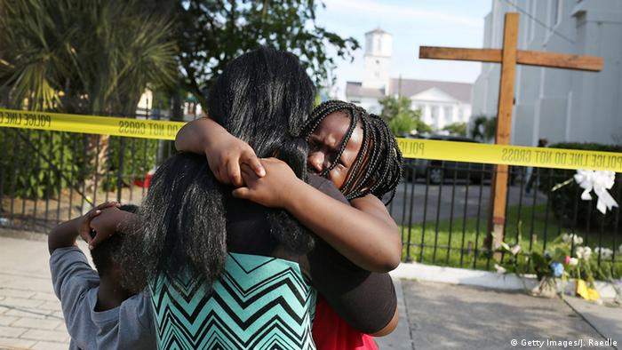 A woman comforts her daughter as they stand in front of the Emanuel African Methodist Episcopal Church following a mass shooting in Charleston, South Carolina (Getty Images/J. Raedle)
