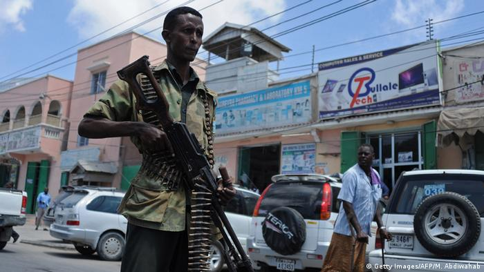 A Somali soldier patrols a street in Mogadishu