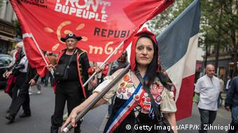 A woman dressed as Marianne, the symbol of the French republic, is seen during a demonstration against austerity in support of the Greek population in Paris, June 20