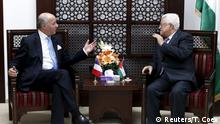 France's Foreign Minister Laurent Fabius (L) gestures as he meets Palestinian President Mahmoud Abbas in the West Bank city of Ramallah June 21, 2015. Prime Minister Benjamin Netanyahu prefaced talks about a French-led peace initiative on Sunday by saying foreign powers were trying to dictate to Israel a deal with the Palestinians. Fabius, on a two-day visit to the Middle East, met Palestinian leaders in the occupied West Bank before seeing Netanyahu later in the day. REUTERS/Thomas Coex/Pool