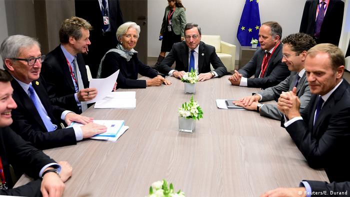 Christine Lagarde and representatives of the European Central Ban and the EU Commission sitting around a table to discuss the Greek debt crisis during a crucial summit in June 2015