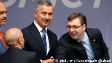 28.05.2015 **** FILE - epa04771860 Kosovo Prime Minister Isa Mustafa (2-L) shakes hand with Serbian Prime Minister Aleksandar Vucic (R) as Albanian Prime Minister Edi Rama (L) and Montenegro's Prime Minister Milo Djukanovic (2-R) look on prior to the Tirana Talks at the Vienna Economic Forum in Tirana, Albania, 28 May 2015. Vienna economic forum is held in the framework of the Berlin summit, where the countries of the region will present their economic projects. Albania, Serbia, Montenegro, Bosnia, Kosovo, Macedonia, and Greece take part in the forum. EPA/ARMANDO BABANI +++(c) dpa - Bildfunk+++