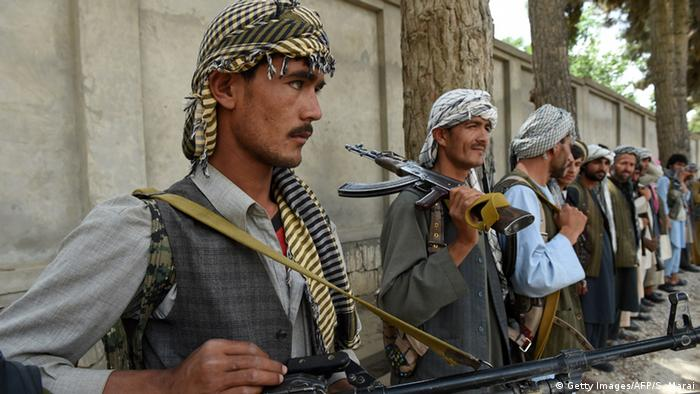 Afghan militia forces as they stand with their weapons in Kunduz (Photo: SHAH MARAI/AFP/Getty Images)