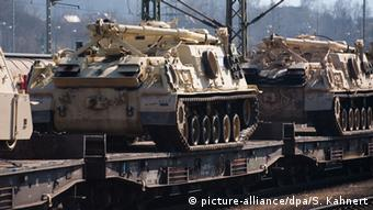 This file photo from March 20, 2015 shows US tanks loaded on a German freight train for military maneuvers in Eastern Europe.