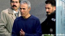 Turkish gunman Mehmet Ali Agca (C) walks through the gate of Kartal jail, as he is released from Kartal jail in Istanbul, Turkey on Thursday 12 January 2006. Mehmet Ali Agca was extradited to Turkey in 2000 after serving almost 20 years in Italy for shooting and wounding the pope in St. Peter's Square in Rome. His motive for the attack remains unclear. Agca, 48, is to be transported to a military base where he will undergo tests to assess his suitability for military service. EPA/KERIM OKTEN +++(c) dpa - Bildfunk+++