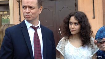 Ivan Pavlov and Ludmilla Savchuk outside the St. Petersburg court Wednesday