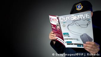A gay member of the US Air Force who chooses to not be identified reads a copy of the new magazine OutServe intended for actively serving lesbian, gay, bi, and transgender, US military members