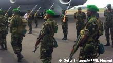 Rwandan troops prepare to board a US military aircraft in Kigali on their way to the Central African Republic as part of an African Union mission to the war-torn nation on January 16, 2014. Rwanda army chief Patrick Nyamvumba saluted the first batch of a total 850 soldiers who Kigali is sending to troubled CAR, as they boarded a US airplane. Rwanda's deployment comes a day after the AU called for more troops to help stabilise CAR. AFP PHOTO/EDWIN MUSONI (Photo credit should read EDWIN MUSONI/AFP/Getty Images)