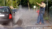 Passengers getting splashed by car