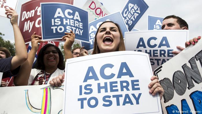 People with Pro-Affordable Care Act signs (Reuters/J. Roberts)