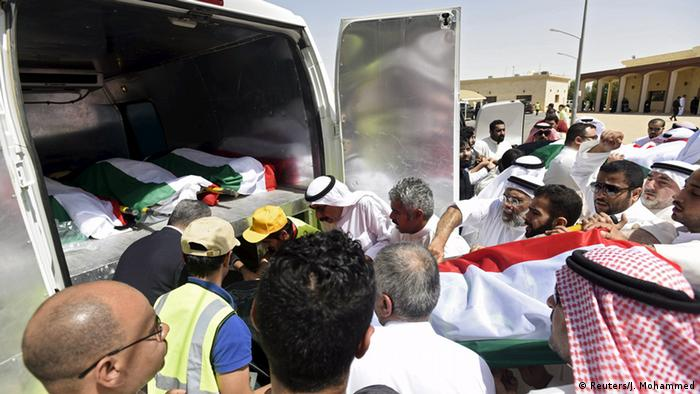Bodies of victims of the Friday bombing are transferred to vehicles to be transported to Karbala, Iraq, at Al Jafariya cemetery in Suleibikhat, Kuwait June 27, 2015 (Photo: REUTERS/Jassim Mohammed)