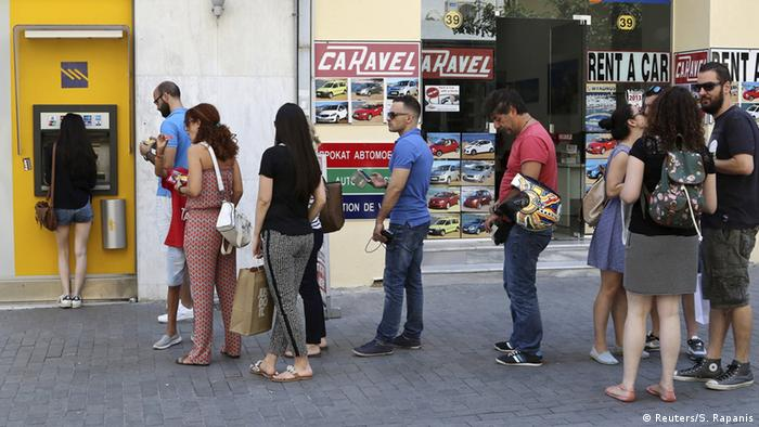 People queue outside ATMs in Greece