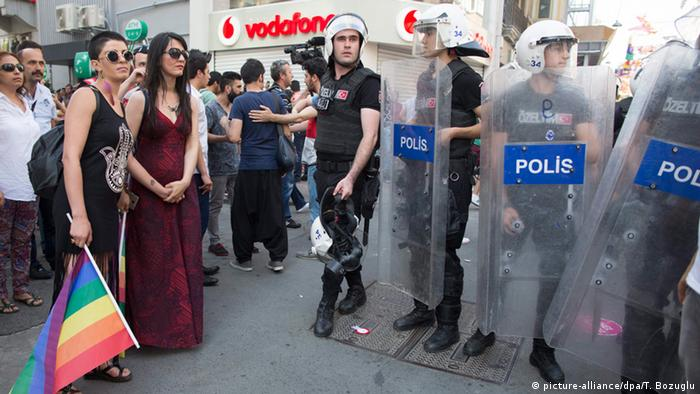 Activists face Turkish riot police blocking a road during a rally on the occasion of the 13th annual Gay Pride Parade in Istanbul