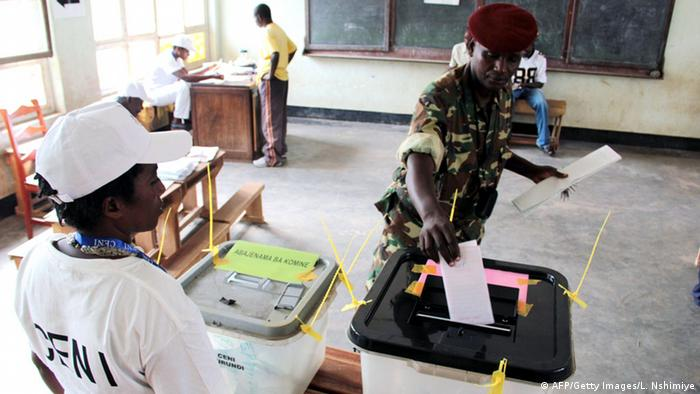 A Burundian soldiers casts his vote