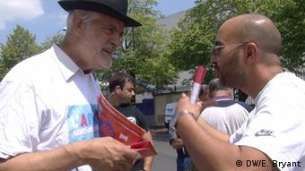 Rabbi Michel Serfaty talks with a man in Courneuve, near Paris