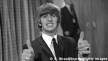 Drummer Ringo Starr, of 'The Beatles', with his thumbs up, June 12th 1964. (Photo by George Stroud/Express/Getty Images)